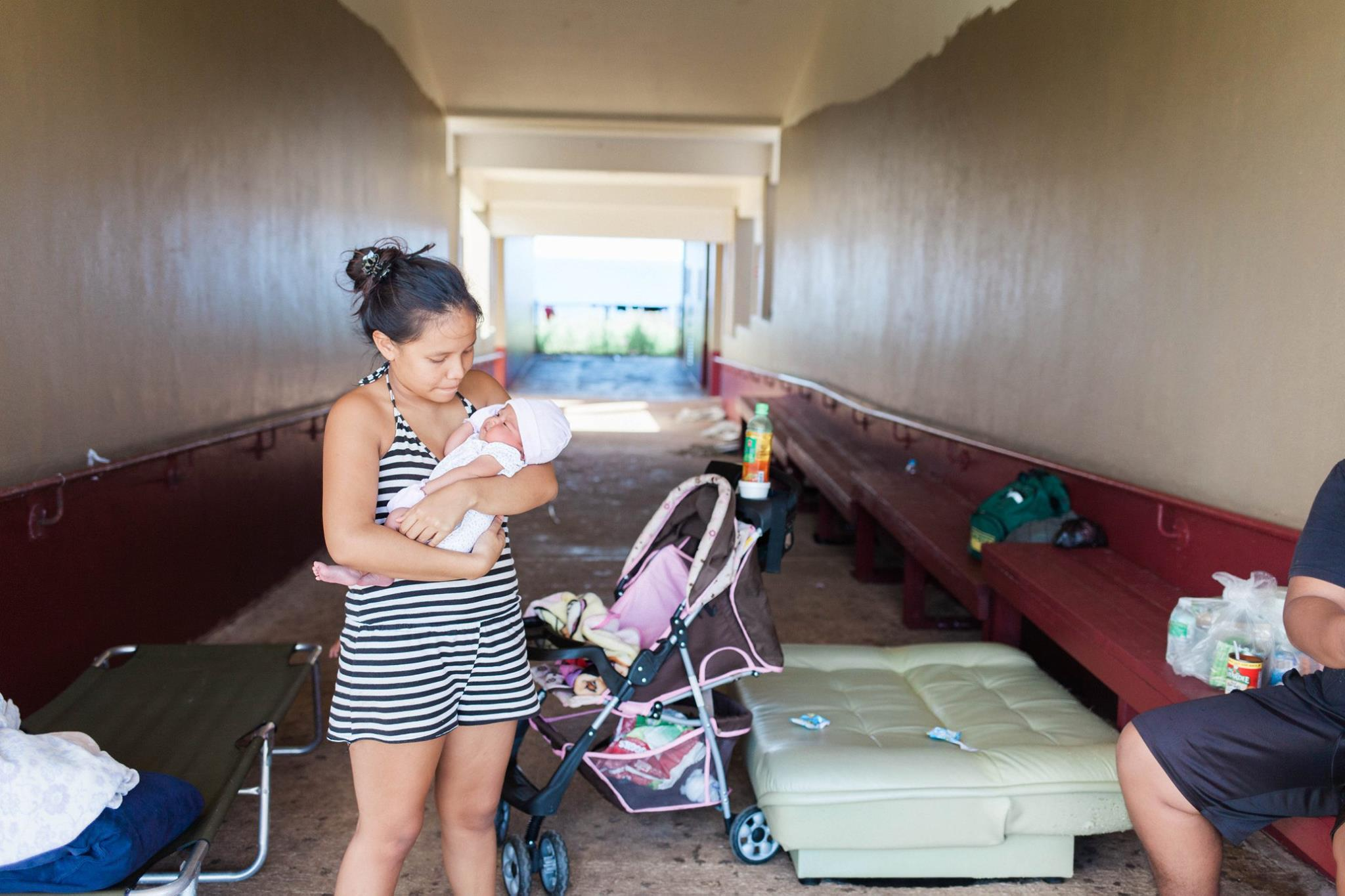 Baby and mother in shelter, Saipan