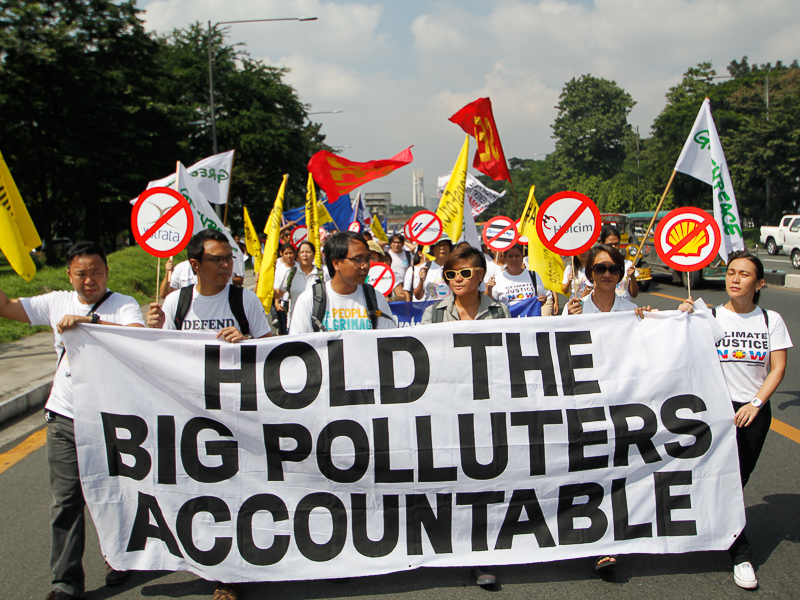 Petitioners including former Climate Change Commissioner, Yeb Sano, was among those present in demanding climate liability. Photo: AC Dimatatac